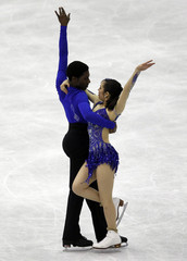 Ralph and Hill of Canada perform during the ice dance short dance at the ISU World Figure Skating Championships in Nice