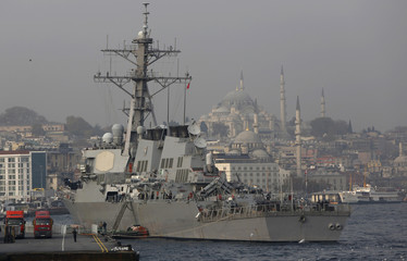 U.S. Navy guided-missile destroyer USS Ross, with the Ottoman-era Suleymaniye mosque in the background, prepares to leave from the port in Istanbul