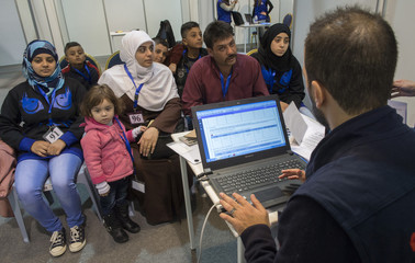 A family of Syrian refugees are being interviewed by authorities in hope of being approved for passage to Canada at a refugee processing centre in Amman, Jordan