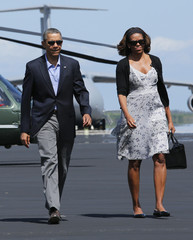 U.S. President Obama and first lady Michelle Obama arrive to board Air Force One at Homestead Air Reserve Base outside Miami