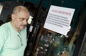 "Minor Blanco, owner of a shop called ""Caza de Tesoros"" (Treasure Hunting), exits his shop in San Jose, Costa Rica"