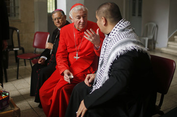 Vincent Nichols, the Archbishop of Westminster, speaks with a priest as he visits Der Latin church in Gaza City