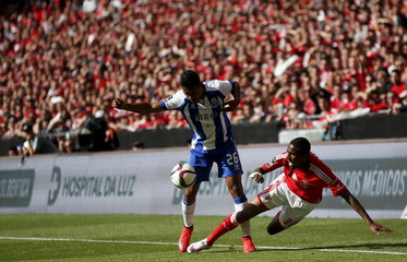 Benfica's Anderson Talisca is tackled by Porto's Alex Sandro during their Portuguese premier league soccer match at Luz stadium in Lisbon