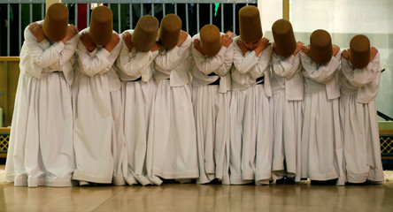 "Apprentice whirling dervishes attend a traditional ""Sema"" ritual during a ceremony, one of many marking the 743rd anniversary of the death of Mevlana Jalaluddin Rumi, at the tomb of Mevlana in Konya"