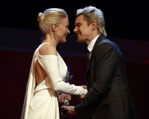 Actor Hawke shakes hands with awarded actress Birn during the Shooting Star awards ceremony at the 63rd Berlinale International Film Festival in Berlin