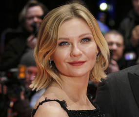Actress Dunst arrives for screening at 66th Berlinale International Film Festival in Berlin