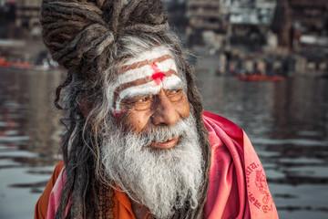 Portrait of sadhu smiling in the boat, Varanasi, India.