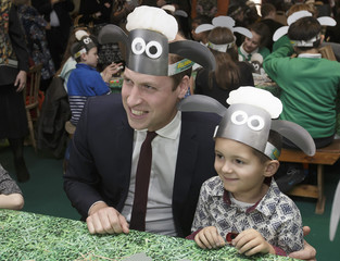 Britain's Prince William poses for photographs with a Shaun the Sheep hat, with children and representatives from charities and Aardman Animations, at the British Academy of Film and Television Arts in London