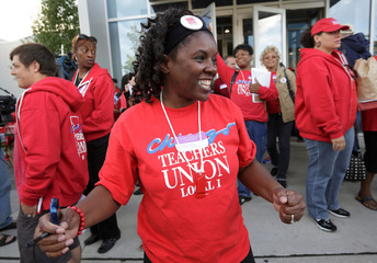Robinson and other members of the Chicago Teachers Union celebrate the end of their strike in Chicago