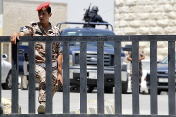 Jordanian security forces guard the state security court during the trial of radical Muslim cleric Abu Qatada in Amman