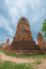 Ruins of buddha statues and pagoda of Wat Mahathat in Ayutthaya historical park, Thailand