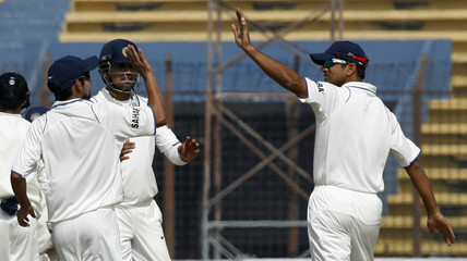 India's Gambhir and Mishra congratulate Dravid during the fifth day of first test cricket match in Chittagong