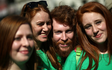 People with red hair pose for pictures as they gather to celebrate World Redhead Day in Buenos Aires