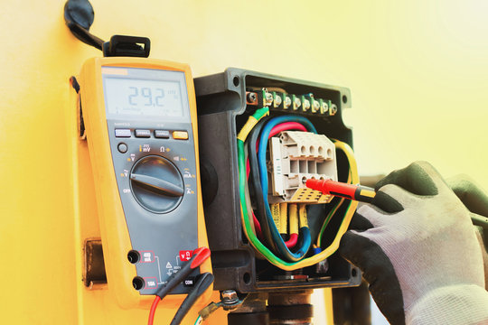 electrician,Hand of electrician on the job function check electical system