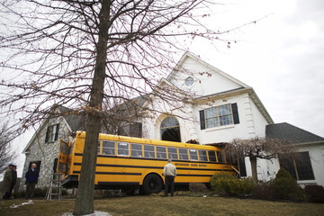 A school bus is pictured after it crashed into a house at the Windermere Development in Blue Bell, Pennsylvania