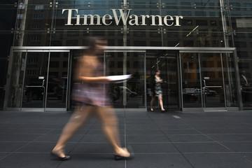 A woman walks past the Time Warner Center near Columbus Circle in Manhattan, New York