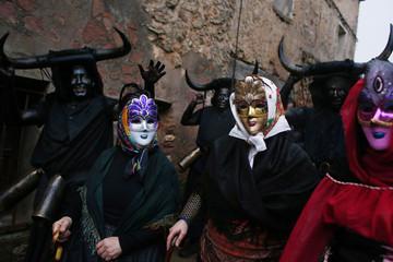"Carnival revellers and ""Diablos de Luzon"" (Luzon Devils) parade during carnival celebrations in the Spanish village of Luzon"