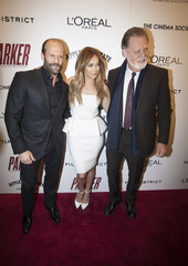 """Cast members Statham and Lopez pose with Hackford for premiere of the film """"Parker"""" in New York"""