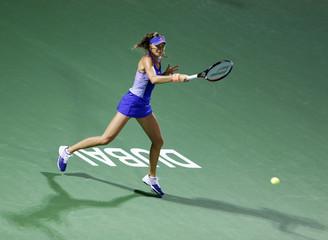 Slovakia's Hantuchova returns the ball to Barthel of Germany during their women's singles tennis match at the WTA Dubai Tennis Championships