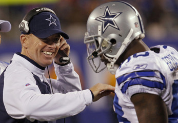 Dallas Cowboys head coach Garrett celebrates with receiver Bryant after Cowboy's first down score during their NFL football game against New York Giants in East Rutherford