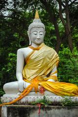 White Buddha Image in garden of Buddhist temple.