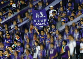 Fans of Japan's Sanfrecce Hiroshima cheer the team before their Club World Cup quarter-final soccer match against TP Mazembe of the Democratic Republic of Congo in Osaka, western Japan