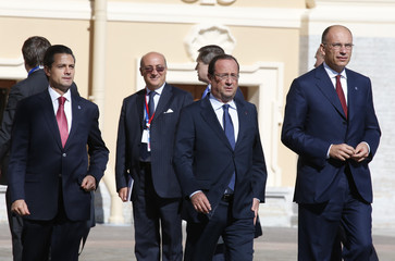 Mexico's President Nieto, French President Hollande and Italy's Prime Minister Letta arrive for the family picture event during the G20 summit in St.Petersburg