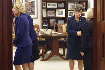 Capito and Ernst greet fellow women senators before a meeting at a hideaway office in the U.S. Capitol in Washington