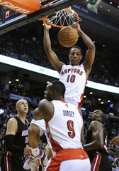 Toronto Raptors DeRozan goes up for a slam dunk against Miami Heat during the first half of their NBA basketball game in Toronto