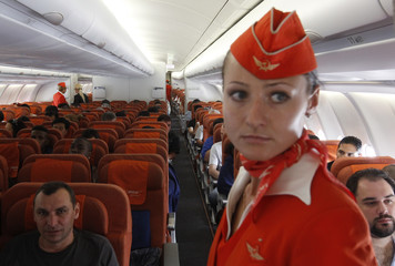 People sit onboard an Aeroflot Airbus A330 plane heading to the Cuban capital Havana at Moscow's Sheremetyevo airport