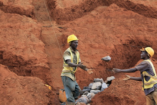 Construction labourers work at a landscaping section of the Mombasa-Nairobi standard gauge railway near Emali