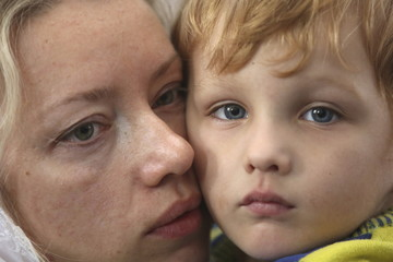 A woman holds a boy during a mass led by Patriarch Kirill at the Russian Orthodox church in Havana
