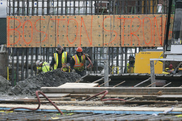 """Construction workers display a sign reading """"Boston Strong"""" on a formwork across the street from the federal courthouse, on the first day of the trial of accused Boston Marathon bomber Dzhokhar Tsarnaev in Boston"""