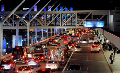 Vehicles transporting Thanksgiving holiday travelers are seen at Los Angeles International Airport in Los Angeles