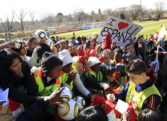 Spain's Torres signs autographs after the end of a soccer training session in Potchefstroom
