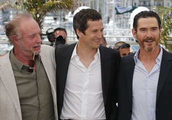 "Director Guillaume Canet poses with ccast members during a photocall for the film ""Blood Ties"" at the 66th Cannes Film Festival"