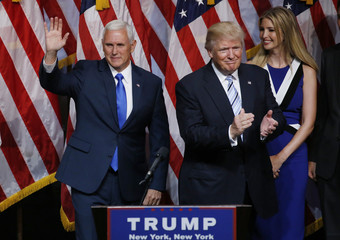 Republican U.S. presidential candidate Donald Trump applauds after introducing Indiana Governor Mike Pence as his vice presidential running mate in New York