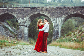 Lovers are standing by the bridge