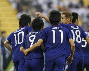 Japan's Shinji Kagawa celebrates with teammates after scoring against Qatar during their 2011 Asian Cup quarter-final soccer match at Al Gharafa stadium in Doha