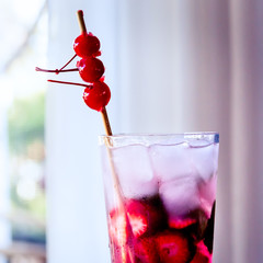 Vodka Cocktail with Strawberries, Mint and Cherries