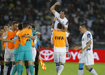 Stankovic of Italy's Inter Milan celebrates with team mate Materazzi after scoring a goal during their Club World Cup semi-final soccer match against South Korea's Seongnam Ilhwa at Zayed Sports City in Abu Dhabi