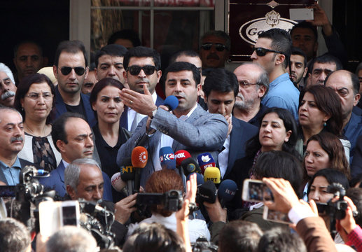 HDP co-leader Demirtas talks during a gathering to protest against the arrest of the city's popular two joint mayors for alleged links to terrorism, in the southeastern city of Diyarbakir