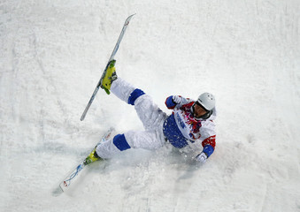 Russia's Sergey Volkov crashes during men's freestyle skiing moguls qualification round at the 2014 Sochi Winter Olympic Games in Rosa Khutor