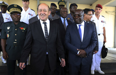 French Defence Minister Le Drian poses for a picture with his counterpart from Ivory Coast Koffi Koffi at Koffi's office in Abidjan