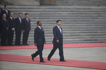 Tanzania's President Kikwete and China's President Xi attend a welcoming ceremony in Beijing
