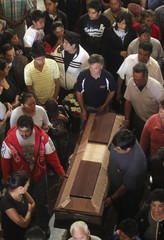 Family members and friends mourn the victims of an oil pipeline explosion in Texmelucan