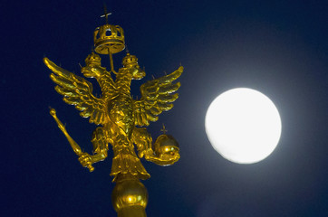 The two-headed eagle is on display at the top of the State Historical Museum, with a full moon seen in the background