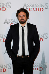 """Director Justin Kurzel poses during a photocall to promote the film """"Assassin's Creed"""" in Paris"""