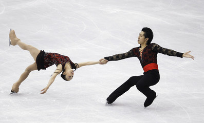 Sui and Han of China perform during the pairs free skating preliminary round at the ISU World Figure Skating Championships in Nice