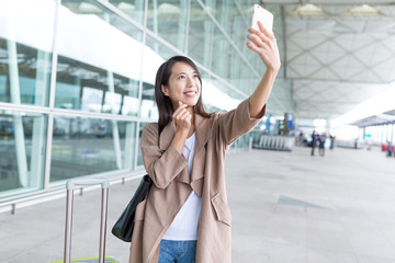 Young asian woman go travel and taking selfie